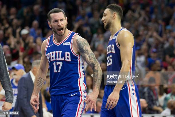 Redick of the Philadelphia 76ers reacts after a made three point basket along with Ben Simmons of the Philadelphia 76ers in the fourth quarter...