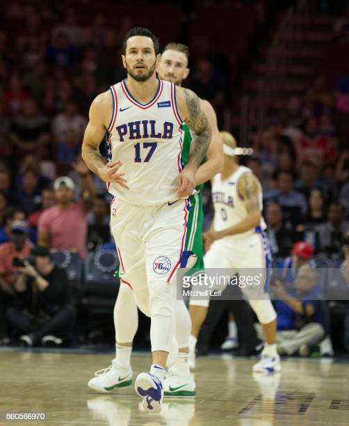 Redick of the Philadelphia 76ers reacts in front of Gordon Hayward of the Boston Celtics at the Wells Fargo Center on October 6 2017 in Philadelphia...