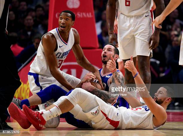 Redick of the Philadelphia 76ers reacts to a possesion call by the referee with Wesley Johnson and Austin Rivers of the LA Clippers during the first...