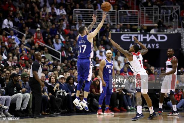 Redick of the Philadelphia 76ers shoots over Bradley Beal of the Washington Wizards at Capital One Arena on October 18 2017 in Washington DC NOTE TO...