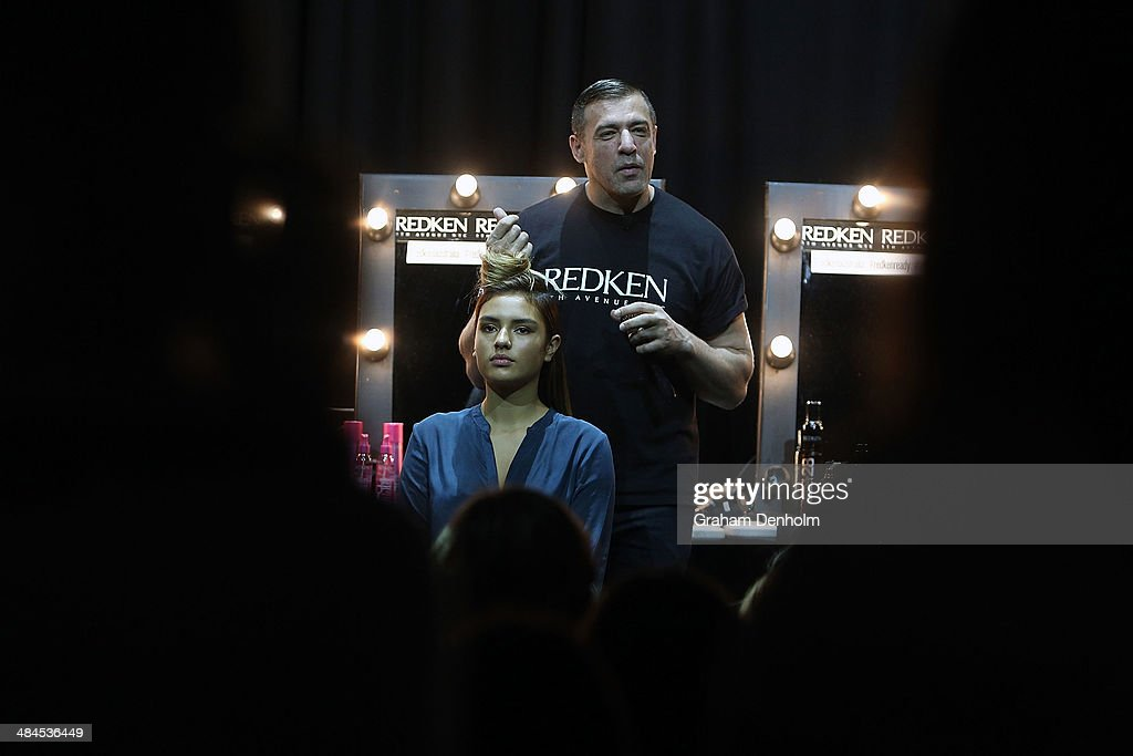 A Redken stylist talks during the Runway Looks: Hair How-To's with Redken 5th Avenue style session at Mercedes-Benz Fashion Week Australia - Weekend Edition at Carriageworks on April 13, 2014 in Sydney, Australia.