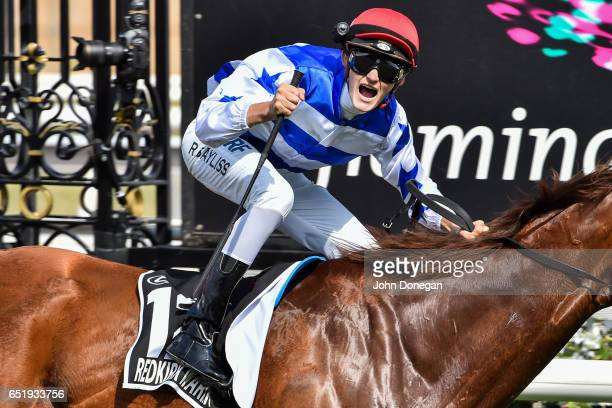 Redkirk Warrior ridden by Regan Bayliss wins the Lexus Newmarket Handicap at Flemington Racecourse on March 11 2017 in Flemington Australia