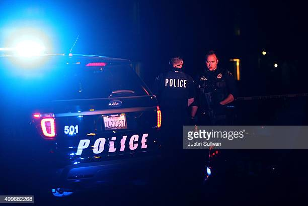 Redlands police officers stand guard as they investigate a suspicious vehicle on December 2 2015 in Redlands California Police continue to...