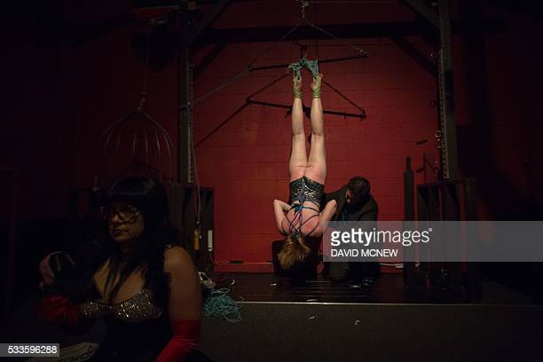 Redlines ties up and suspends voluntary submissive Mermaid at a dungeon party during the DomCon LA domination convention on May 21 2016 in Los...