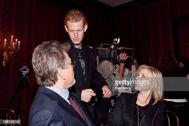 Redmond O'Neal son of Farrah Fawcett talks with his father actor Ryan O'Neal and halfsister Tatum O'Neal at a Farrah Fawcett memorabilia donation...