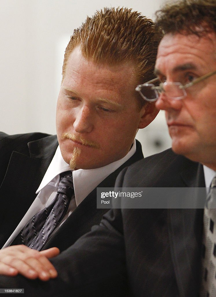 Redmond O'Neal thanks his attorney, Richard Pintal with a pat on the arm inside the Airport Branch Courthouse October 9, 2012 in Los Angeles, California. O'Neil, the son of actors Ryan O'Neal and the late Farrah Fawcett was warned by Judge Keith Schwartz that if he violated any conditions of the probation that he would be sent to jail for six years.