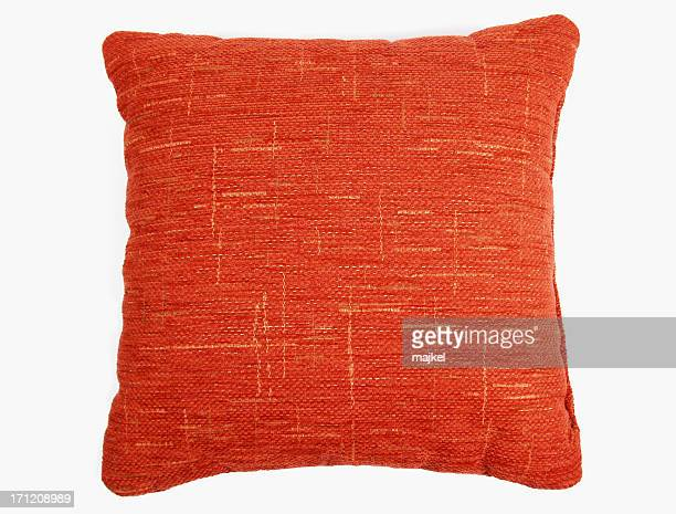 Red-orange square couch pillow with yellow design