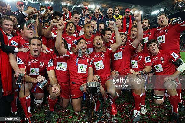 Reds celebrate winning the 2011 Super Rugby Grand Final match between the Reds and the Crusaders at Suncorp Stadium on July 9 2011 in Brisbane...