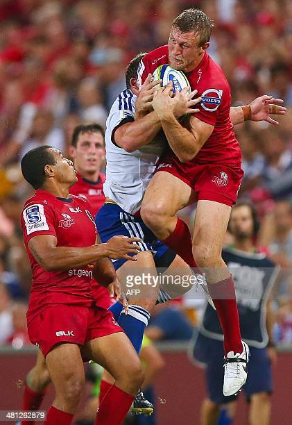Reds fullback Lachie Turner leaps to take a highball during the Super 15 rugby union match at Suncorp Stadium in Brisbane on March 29 2014 AFP PHOTO...