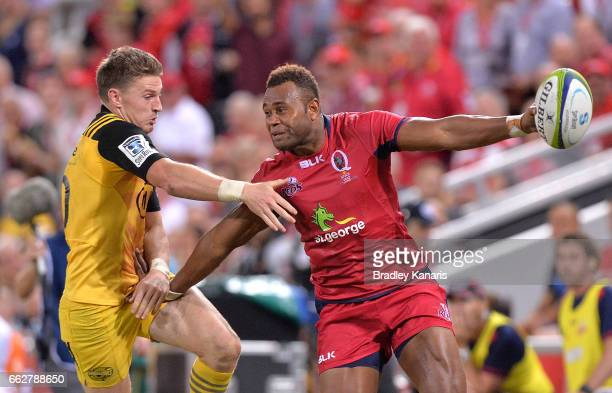 Reds player Eto Nabuli pushes away from the defence during the Super Rugby round six match between the Reds and the Hurricanes at Suncorp Stadium on...