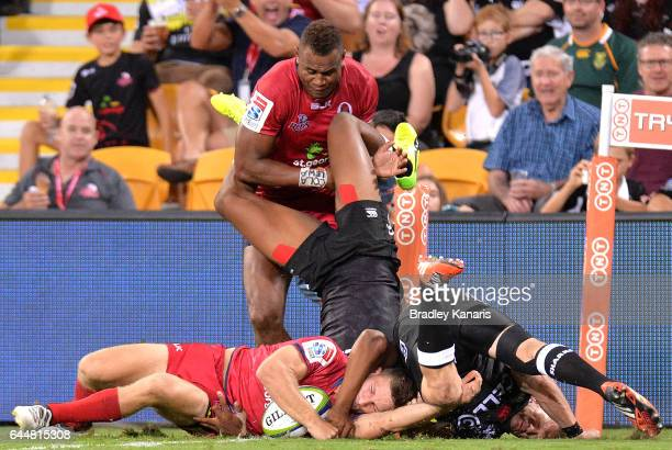 Reds player James Tuttle scores the match winning try during the round one Super Rugby match between the Reds and the Sharks at Suncorp Stadium on...