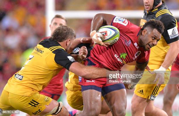 Reds player Samu Kerevi attempts to break away from the defence during the Super Rugby round six match between the Reds and the Hurricanes at Suncorp...