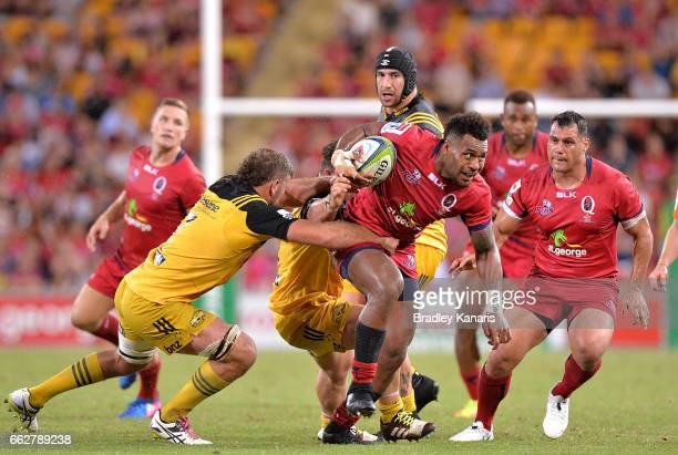 Reds player Samu Kerevi attempts to breaks away from the defence during the Super Rugby round six match between the Reds and the Hurricanes at...
