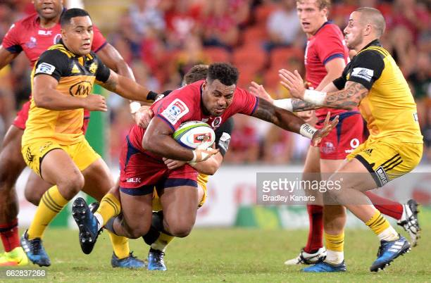 Reds player Samu Kerevi takes on the defence during the Super Rugby round six match between the Reds and the Hurricanes at Suncorp Stadium on April 1...