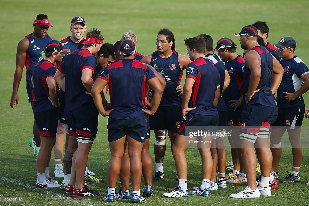 Reds players talk during a Queensland Reds Super Rugby training session at Ballymore Stadium on February 8, 2016 in Brisbane, Australia.