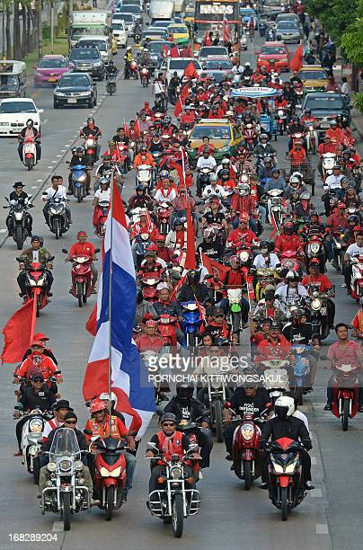 Redshirt protesters wave a giant Thai national flag as they demonstrate in front of the Constitutinal Court in Bangkok on May 8 2013 Redshirt...