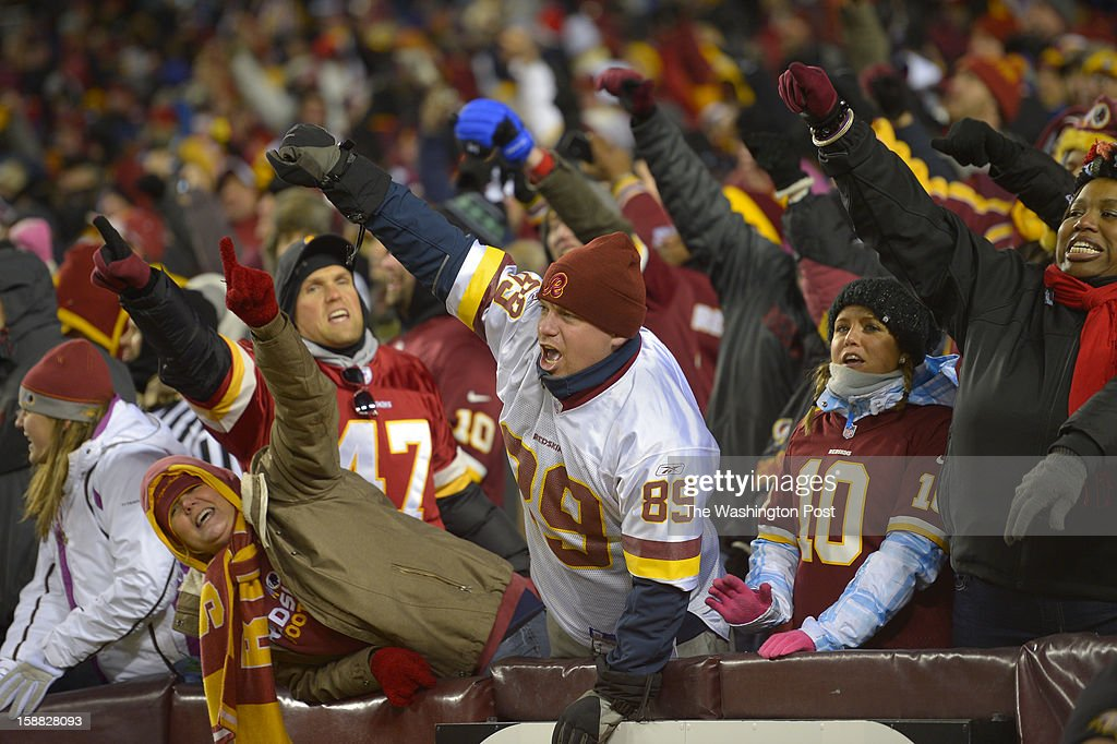 Redskins fans celebrate a third-quarter touchdown by Washington running back Alfred Morris (46) as the Washington Redskins play the Dallas Cowboys for first place of the NFC East division and a playoff spot at FedEx in Landover MD, December 30, 2012 .