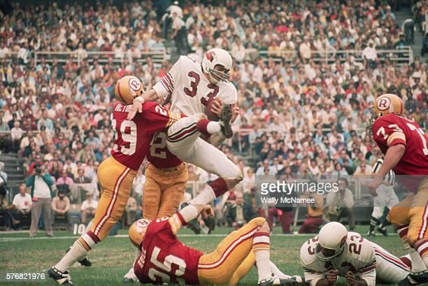 Redskins Players Tackling a Cardinals Receiver