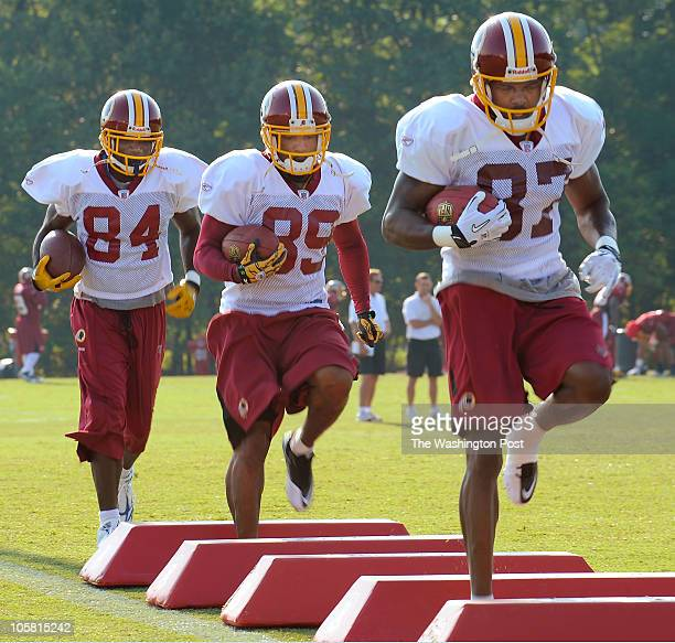 Redskins receivers Joey Galloway left Sanata Moss center and Roydell Williams right run drills as the Washington Redskins conduct their 4th day of...