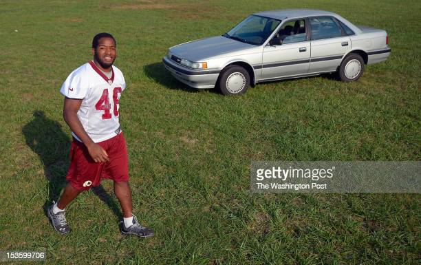 Redskins' running back Alfred Morris poses with his 1991 Mazda 626 at Redskins Park in Ashburn VA October 4 2012