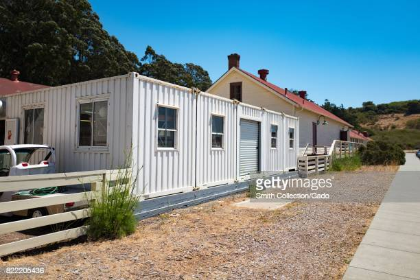 Redtopped historical buildings with temporary corrugated iron buildings are visible at Fort Baker in the Marin Headlands Marin County Sausalito...