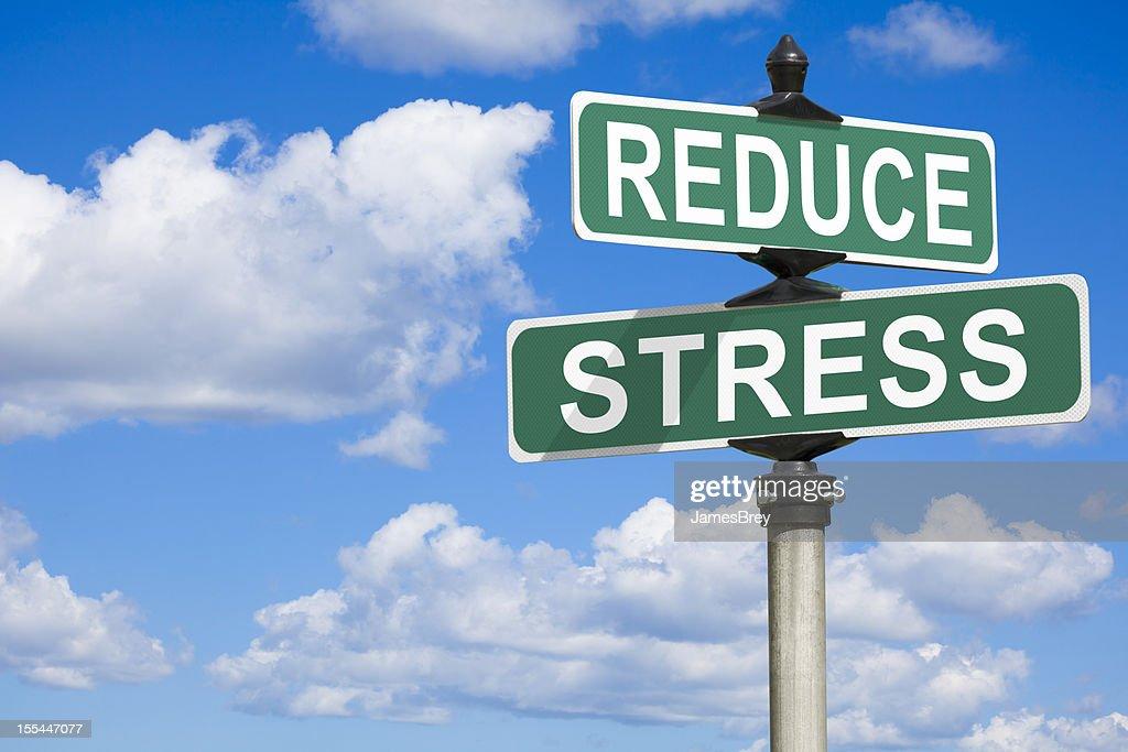 Ridurre lo Stress strada segno : Foto stock