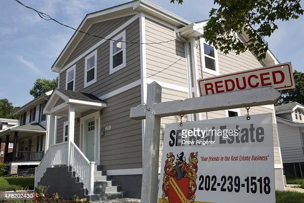 A 'Reduced' sign sits in the front yard of a house for sale June 23 2015 in Northeast Washington DC Purchases of new homes in the US rose in May to...