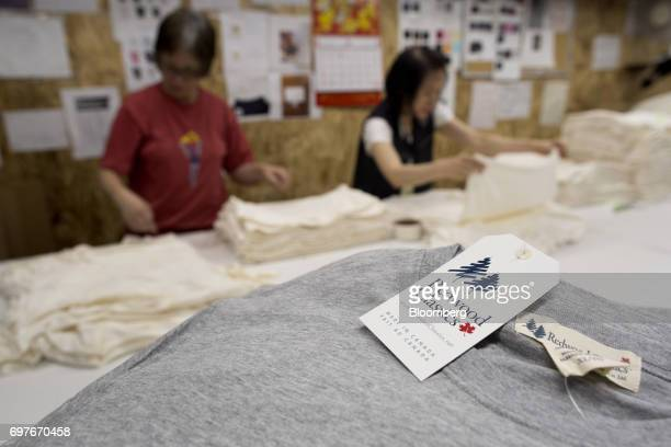 A Redwood Classics brand shirt tag reads 'Made In Canada' at the WS Co production facility in Toronto Ontario Canada on Friday June 9 2017 Canada Day...