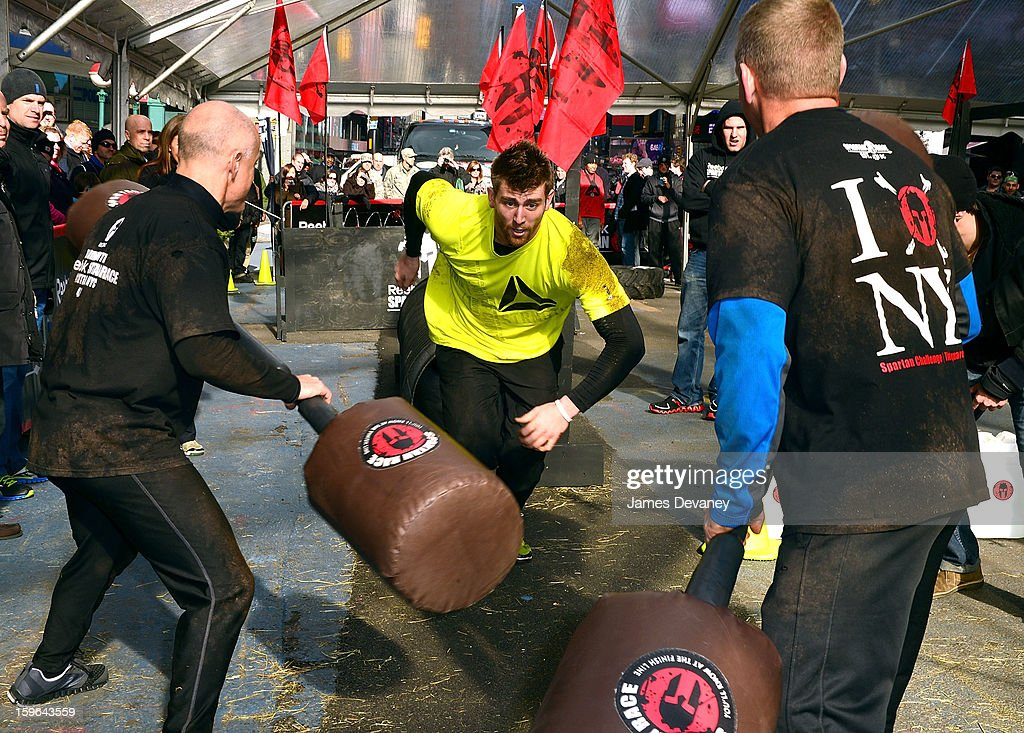 Reebok CrossFit athlete Spencer Hendel tackles The Reebok Spartan Race Times Square Challenge in Times Square on January 17, 2013 in New York City.