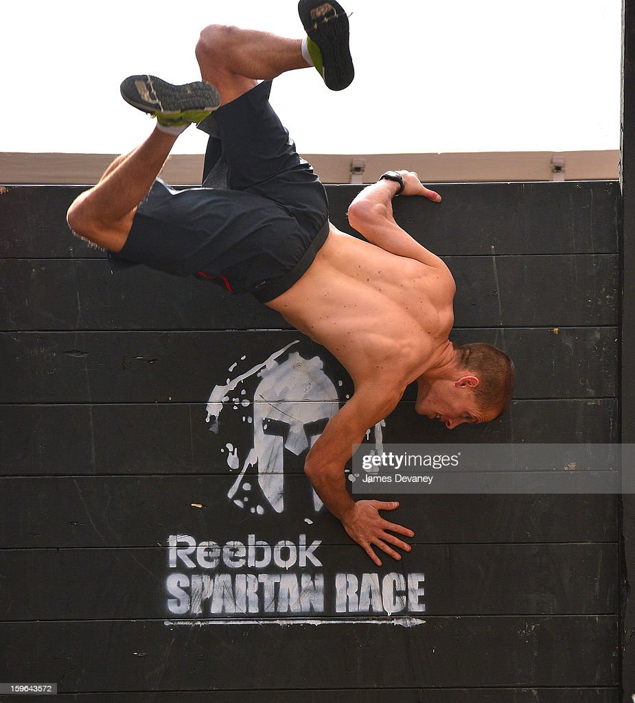 Reebok Spartan Race athlete Hobie Call tackles The Reebok Spartan Race Times Square Challenge in Times Square on January 17, 2013 in New York City.