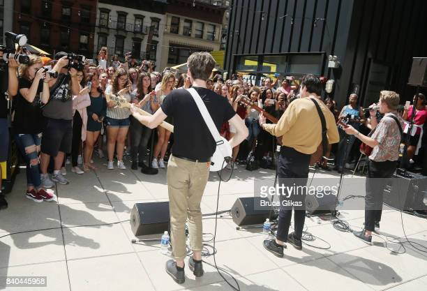 Reece Bibby Blake Richardson and George Smith of the band 'New Hope Club' perform at a fan concert and meet greet at Buffalo Wild Wings Times Square...