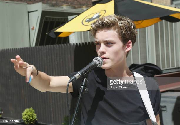 Reece Bibby of the band 'New Hope Club' performs at a fan concert and meet greet at Buffalo Wild Wings Times Square on August 28 2017 in New York City
