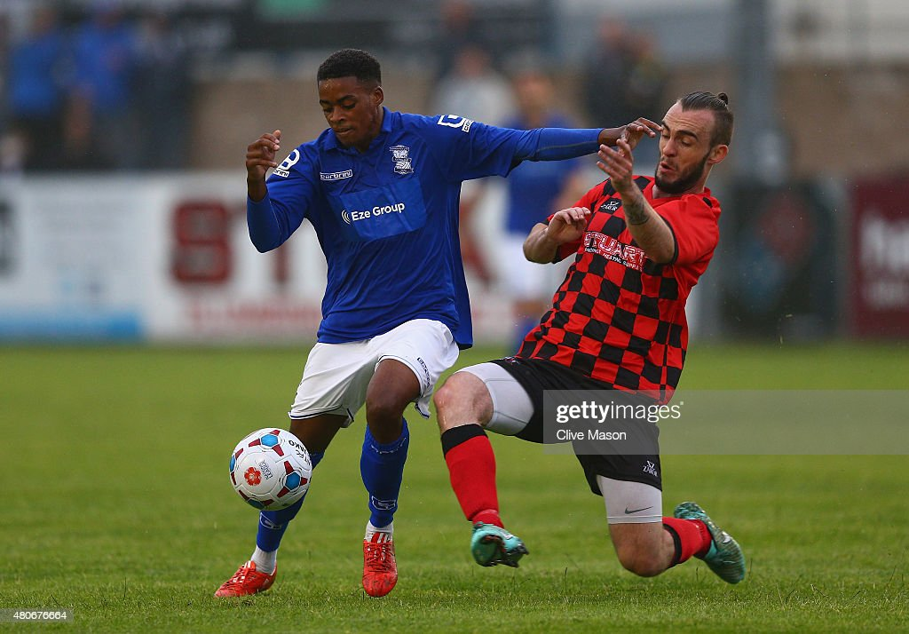 Reece Brown of Birmingham City is challenged by Shane Byrne of Nuneaton Town during the pre season friendly match between Nuneaton Town and...