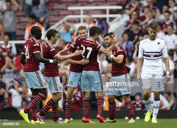 Reece Burke of West Ham United celebrates scoring the winning goal with his team mates during the preseason friendly match between West Ham United...