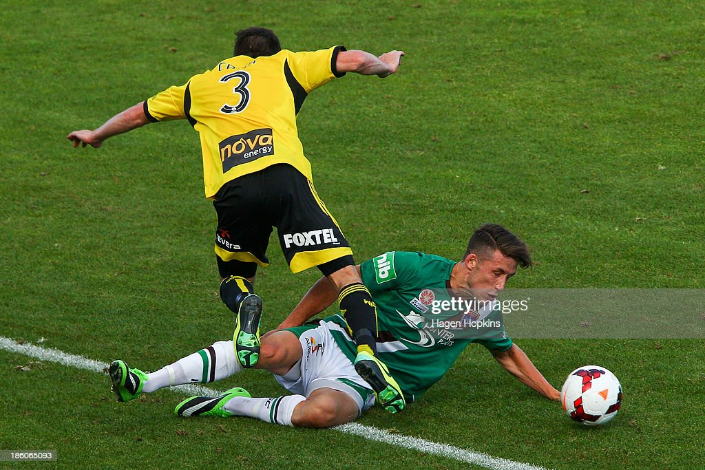 Reece Caira of the Phoenix is tackled by Scott Neville of the Jets during the round three A-League match between Wellington Phoenix and the Newcastle Jets at McLean Park on October 27, 2013 in Napier, New Zealand.