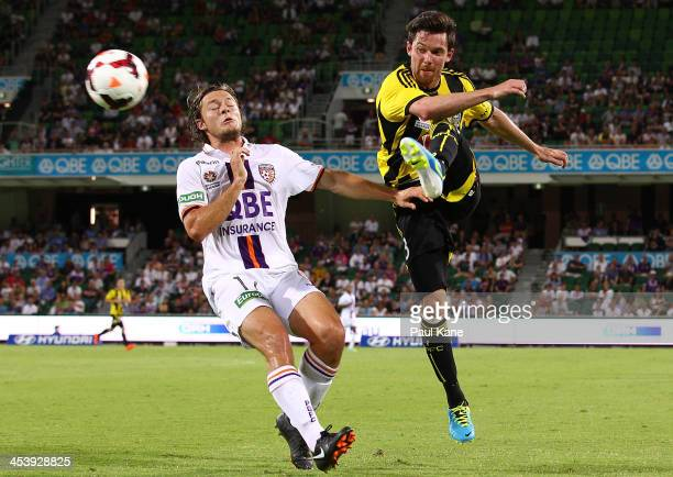 Reece Caira of the Phoenix passes the ball against Chris Harold of the Glory during the round nine ALeague match between Perth Glory and the...