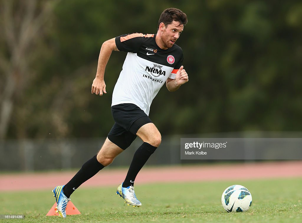 Reece Caira runs the ball during a Western Sydney Wanderers A-League training session at Blacktown International Sportspark on February 12, 2013 in Sydney, Australia.