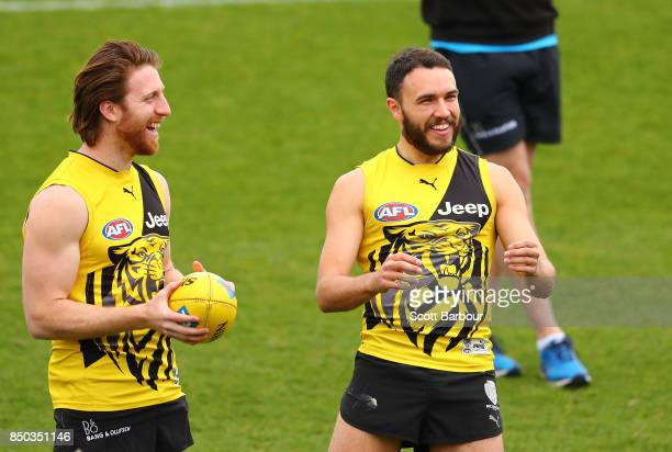 Reece Conca and Shane Edwards of the Tigers smile during a Richmond Tigers AFL training session at Punt Road Oval on September 21 2017 in Melbourne...