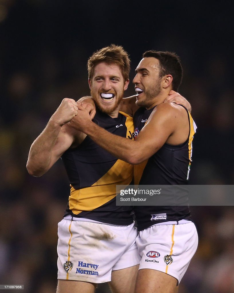 Reece Conca of the Tigers celebrates after kicking a goal during the round 13 AFL match between the Western Bulldogs and the Richmond Tigers at Etihad Stadium on June 22, 2013 in Melbourne, Australia.