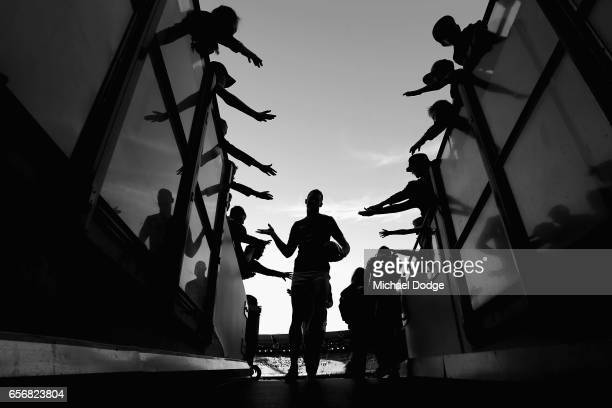 Reece Conca of the Tigers is greeted by fans during the round one AFL match between the Carlton Blues and the Richmond Tigers at Melbourne Cricket...