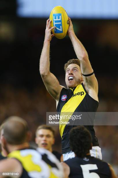 Reece Conca of the Tigers marks the ball during the round one AFL match between the Carlton Blues and the Richmond Tigers at Melbourne Cricket Ground...