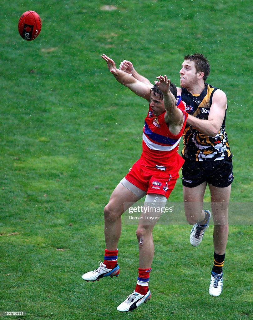 Reece Conca of the Tigers spoils the ball during the AFL practice match between the Richmond Tigers and the Western Bulldogs at Visy Park on March 16, 2013 in Melbourne, Australia.