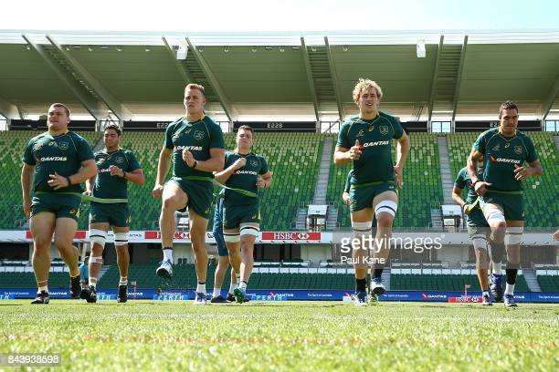 Reece Hodge and Ned Hanigan of Australia warms up during the Australian Wallabies Captain's Run at nib Stadium on September 8 2017 in Perth Australia