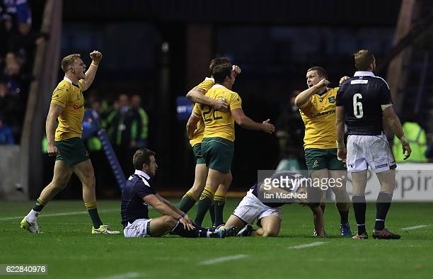 Reece Hodge and Tom Robertson of Australia celebrates at full time during the Scotland v Australia Autumn Test Match at Murrayfield Stadium on...