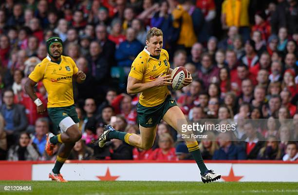 Reece Hodge of Australia runs in his team's second try during the international match between Wales and Australia at the Principality Stadium on...