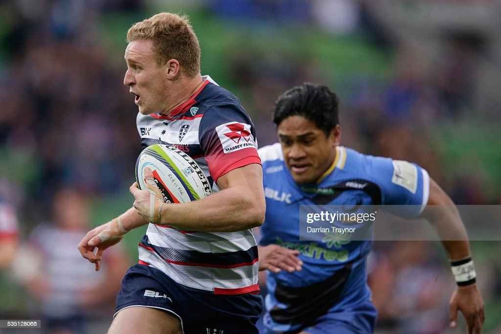 Reece Hodge of the Rebels breaks through for a try during the round 14 Super Rugby match between the Rebels and the Force at AAMI Park on May 29, 2016 in Melbourne, Australia.