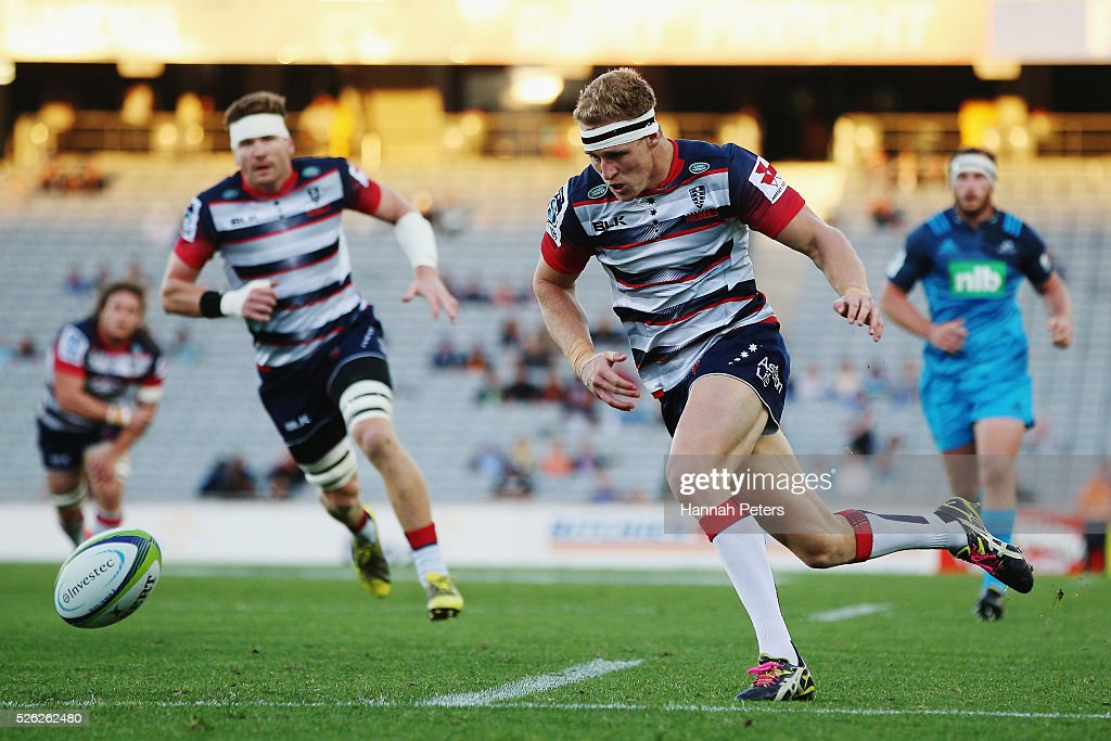 Reece Hodge of the Rebels chases the ball down to score a try during the Super Rugby round ten match between the Blues and the Melbourne Rebels at Eden Park on April 30, 2016 in Auckland, New Zealand.