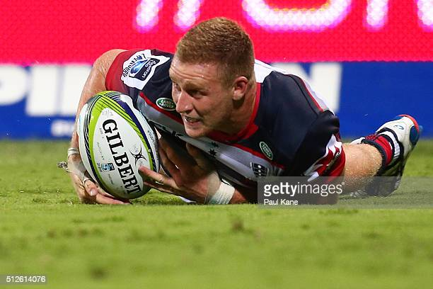 Reece Hodge of the Rebels crosses for a try during the round one Super Rugby match between the Force and the Rebels at nib Stadium on February 27...