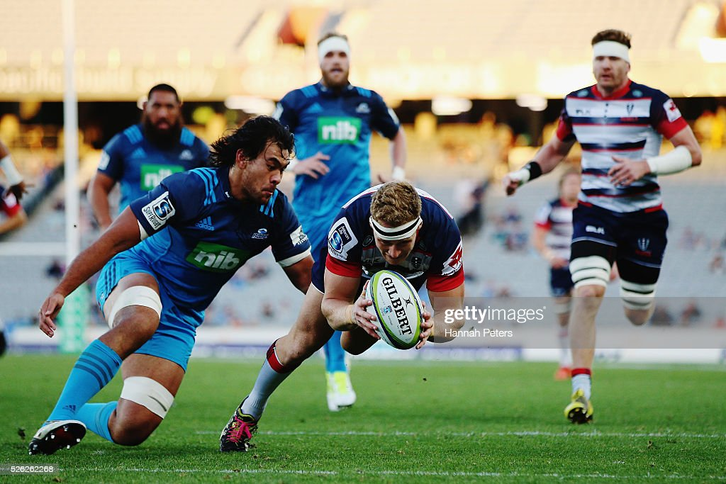 Reece Hodge of the Rebels dives over to score a try during the Super Rugby round ten match between the Blues and the Melbourne Rebels at Eden Park on April 30, 2016 in Auckland, New Zealand.