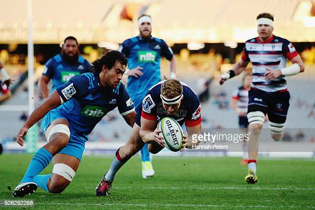 Reece Hodge of the Rebels dives over to score a try during the Super Rugby round ten match between the Blues and the Melbourne Rebels at Eden Park on...